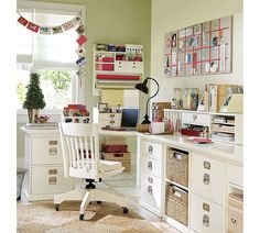 Love this white craftroom, nice hidden storage and light through the window..