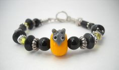 Mouse on Cheese Wheel Bracelet Glass Bead by HerBeautyFound, $15.00 pet mouse, mouse accessory, cute jewelry, pet jewelry, mixed bead, silver, black, gray, yellow, orange, animal jewelry, animal bracelet, whimsical jewelry, unique jewelry, handmade, handcrafted, jewelry gifts under 20