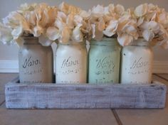 Center piece with mason jars sprayed in pastel colors