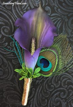 Purple calla lily and peacock feather boutonniere with metallic gold ribbon stem wrap and accent foliage. #boutonniere #peacockfeather #callalily #peacock #feather #lily