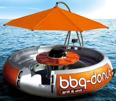 A BBQ by the lake is always fun, but what about one out on the lake? The BBQ Donut Boat lets you take 10 people on an incredible outing. The BBQ Donut is a round floating picnic table, BBQ grill, and parasol that you can Barbecue, Lake Toys, Grill N Chill, Boat Grill, Boat Bbq, Pool Floats, Lake Floats, Parasol, Cool Inventions