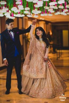 Candid Couple Shot - Twirling Bride in a Gold and Peach Sequinned Lehenga and Groom in a Black Suit Indian Wedding Couple Photography, Indian Wedding Photos, Wedding Couple Photos, Indian Wedding Planning, Wedding Photography Poses, Wedding Couples, Wedding Bride, Wedding Lehnga, Bridal Lehenga
