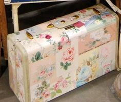 Cover old suitcase with pretty pics and decoupage.