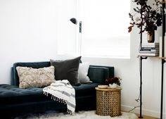 A cozy corner with Turkish and Moroccan elements paired with industrial shelves and a midcentury chaise