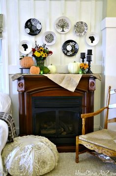 Fall mantel with painted dollar store plates. Tutorial on how to add designs to the plates.