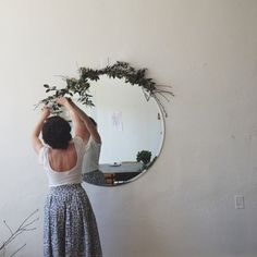 Add greenery around a mirror