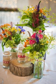 Multi Colour Flowers Wild Logs Jars Centrepiece Colourful Country Barn Street Food Wedding http://www.rocksaltphotography.com/