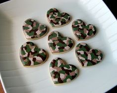 camo valentine cookies cut with heart cookie cutters.