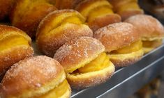 Bolas de berlim are creamy filled confections that sell out twice a day in the small Portuguese port town of Viana do Castelo Portuguese Desserts, Portuguese Recipes, Portuguese Food, Desert Recipes, Doughnuts, Custard, Hot Dog Buns, Portugal, Cake Recipes