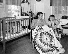No date was given for this photo of a woman hand piecing a Lone Star quilt, but (to me) it appears to date from the 1930s or 1940s.