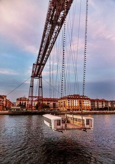 The Vizcaya Bridge in Biscay, Spain connects the two towns of Portugalete and Las Arenas over the Ibaizabal River. The locals refer to the bridge as Puente Colgante, meaning suspension bridge, even though it is a transporter bridge, with a different structure. This bridge also happens to be the world's oldest transporter bridge, as it was built in 1893. Its gondola can transport six cars, as well as passengers and cyclists.