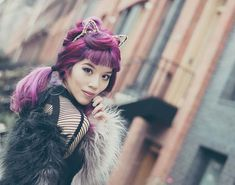 cat ears headband, bright purple hair girl, la carmina colored hair. La Carmina in a faux fur jacket and cat-ears headband - CatWoman cosplay or costume DIY outfit! More photos at http://www.lacarmina.com/blog/2016/01/cat-woman-cosplay-costumes-catfe-vancouver-cafe/  japanese makeup