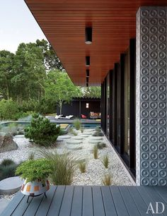 Concrete pavers lead from the dining terrace to the pool | archdigest.com