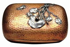 This mixed-metal soap dish by Gorham has brass inside, copper outside and applied lilies, crabs and frogs of copper and silver.