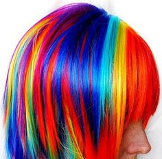 Rainbow color hair.  Go to www.YourTravelVideos.com or just click on photo for home videos and much more on sites like this.