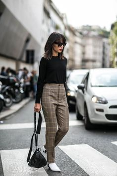 The checked trouser gets a modern update via Balenziaga with a high-waist and stirrups. Evangelise Smyrniotaki wore hers at #PFW with the label's slant-heel #boots.  Head to MATCHESFASHION.COM to shop the look now.