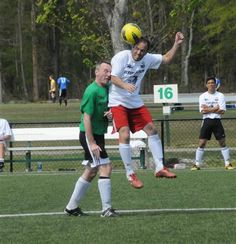 OTSL over 30 Men's division player shows he still has jumping ability winning the ball well over the defender