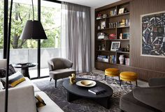 Our clients' collection of art, books and artefacts informed the interior of this new contemporary home in Melbourne. Our input was predominantly decorative, with the brief to transform the space into a warm and comfortable home, incorporating some of their furniture and, of course their collections. Hare + Klein Team: Meryl Hare + Anna Douglass …