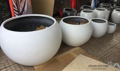 A set of four light-weight and durable round fiberglass planters in elegant white colors.  Website: www.hoangpottery.com  #hoangpottery #fiberglassplanters #fiberglasspots #gardendecoration #decor #outdoordecoration #indoordecoration #decoration Colors Website, Fiberglass Planters, White Colors, Vase, Canning, Mugs, Elegant, Antiques, Decoration