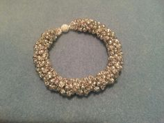 Silver and white beaded bracelet