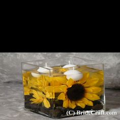 Sunflowers in water. Floating candles.