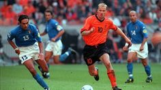 UEFA EURO 2000, 29 June 2000 in Amsterdam : Alessandro Nesta (left, Italy, 1996–2006, 78 caps, 0 goal) pursued Dennis Bergkamp (right, Netherlands, 1990–2000, 79 caps, 37 goals). Italy eliminated the Netherlands in the semi-finals, despite going down to ten men and facing two penalty kicks. Italian goalkeeper Francesco Toldo, who had been drafted into the starting XI as Gianluigi Buffon missed the tournament through injury, made two saves in the penalty shootout (in addition to his penalty…