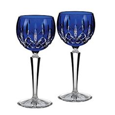 These timeless Waterford glasses update the dazzling crosshatch Lismore pattern in regal cobalt and clear crystal. | Crystal | Hand wash | Imported | 7.5"