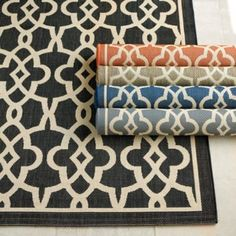Beaufort Indoor Outdoor Rug - when the terracotta color is set up in an outdoor room with the same color outdoor drapes, black aluminum outdoor furniture with all white cushions and light grey stone floors columns and fireplace, the look is sophisticated, welcoming and has just the right amount of color.