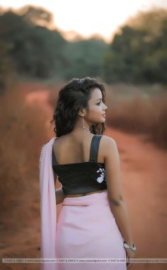 PRICE INR 7,842/-; US$ 118.00 To buy click here https://www.eastandgrace.com/products/ella-silk-chiffon-saree Featuring the delicate Ella pure silk-crepe saree in baby pink, decorated with crystals along the edges. The black blouse is embroidered with white ornaments along the bust, elegantly complementing the pink saree. Reach us: care@eastandgrace.com