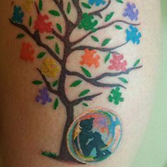 Autism #tattoo #tree #puzzle #pieces #child in his #bubble #