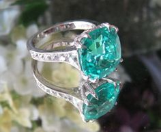 Amazing paraiba tourmaline ring with French cut side stones