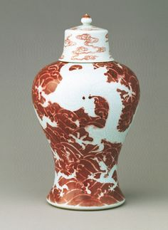 Lidded jar decorated with white dragons and ocean waves on a red ground Yongzheng reign (1723-1735), Qing dynasty
