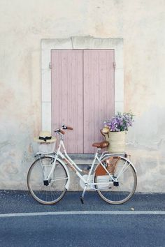 Charming bicycle with French market basket (Vivi et Margot) of flowers and pink shutters on window. Vivi et Margot. Come be inspired by more French farmhouse design inspiration on Hello Lovely. #vivietmargot #bicycle #pink #frenchfarmhouse #frenchbasket #marketbasket #romanticdecor French Farmhouse, Farmhouse Design, French Country, Rustic French, French Cottage, Farmhouse Style, Photo Wall Collage, Picture Wall, Pink Aesthetic
