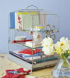 Get yourself sorted with a cagey mail center. Scrub the framework of the birdcage with a bleach solution. Then clip off the wires from the front and back, leaving a few to create mail slots.  To make shelves, cut dowel rods slightly longer than the cage width and notch the wood to help it grab the wires. Cut glass or plexiglass shelves to fit, and place them on the dowel rods.