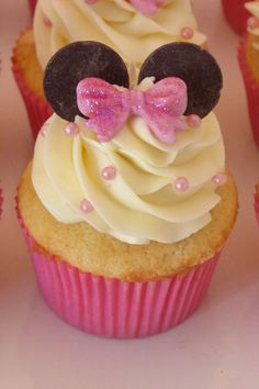 Minnie Mouse Cupcake for child's birthday.  Vanilla cake with vanilla buttercream, fondant bows, pink pearls and chocolate wafers for ears.