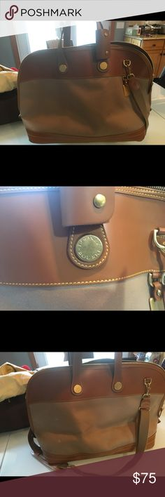 Dooney and Bourke travel bag Large dooney and Bourke travel bag. It holds a lot and is great as a carry on. Dooney & Bourke Bags Travel Bags