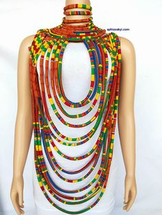 this adorable necklace is made with carefully selected african print, designed for the bold and beautiful, multi strand shoulder to shoulder necklace, perfect for any occasion with a durable lace strap at the back SHIPPING most items are made when ordered ,each item has a processing time