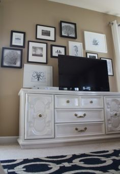 So want to find an old dresser to use as our TV stand.  Also like the small gallery wall behind the TV.