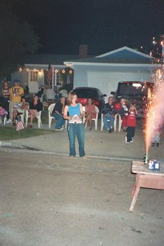 "Our city still allows ""safe and sane"" fireworks.  We decided to have a party for as long as this privilege last.  Notice the light up stars on the house.  They are actually Christmas decorations.  The writing on the ground is done with sparklers."