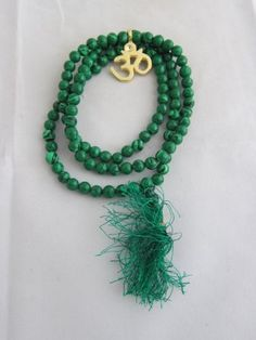 Malachite Full Mala Spiritual Yoga Meditation Japamala~ 108+1 Beads Golden Om Pendant - The Stone of Transformation mogul interior, http://www.amazon.com/dp/B00B7Z8R0C/ref=cm_sw_r_pi_dp_suscrb1TRYMES