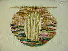 Handmade Woven Textile Wall Hanging by Silvia Hara. Size: 19.7 x 19.7 ''. $210,00, via Etsy.