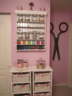 Love the storage and the giant scissors on the wall.