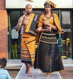 Couple In Beautiful Orange and Black Xhosa Umbhaco Traditional Attire - Clipkulture Couple In Beautiful Orange and Black Xhosa Umbhaco Traditional Attire South African Fashion, Latest African Fashion Dresses, African Print Dresses, African Wear, African Attire, Africa Fashion, South African Traditional Dresses, Traditional Outfits, Traditional Weddings