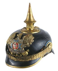 """German; 92nd (Brunswick) Infantry Regiment, 3rd Battalion, Officer's helmet. Solid black leather body shows some surface spiders/lines. Gilt brass flat chinscales. Round base/spike, spine and trim on front visor. Elaborate tiered front plate consisting of an age toned silver oak leaf decorated """"PENINSULA"""" banner affixed to a blue enameled cross, with a detailed galloping horse/crowned pillar - on a red enameled center; all applied to a convex silver starburst which is affixed to a"""
