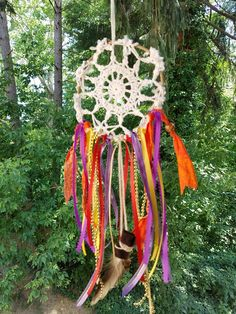 Handmade whimsical Boho Dreamcatcher made with wire, ribbons, yarn and antique lace.