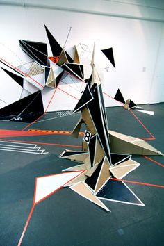 """Clemens Behr Disorder Installation in the Museum of Sculptures """"Glaskasten"""" Marl, Germany (2009) It was made in 4 days for the exhibition """"Trashism/Trashismus"""", Cardboard, paint, tape, trashbags and numbers to confuse."""
