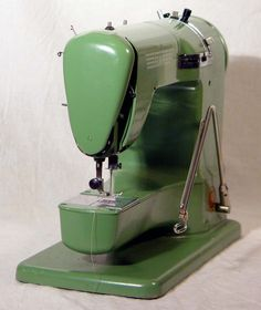 Green Elna Super-Matic Sewing Machine 1956 Perfect Working Order With Cams and Full Instructions. Is this the one they call the grasshopper? Sewing Machine Accessories, Antique Sewing Machines, Sewing Stitches, Sewing Rooms, Sewing Notions, Vintage Posters, Vintage Items, Antiques, Dieselpunk