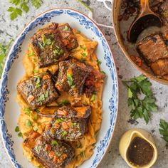 We love these DUTCH OVEN HONEY BOURBON SHORT RIBS! It's so easy to make these flavorful and fall off the bone ribs right in your dutch oven. Less cleanup and more flavor! http://yumgoggle.com/honey-bourbon-short-ribs/ The Cookie Rookie