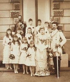 Photograph of Wedding Group, Osborne. Back row: Prince Alexander of Battenberg, Princess Louise of W. Queen Victoria Children, Princess Victoria, Princess Louise, Princess Beatrice, Prince Henry, Prince Albert, Queen Victoria's Daughters, Maud Of Wales, Victoria's Children