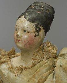 Early Papier Mache Shoulder Head Lady Doll, Germany, c. 1825, blue painted eyes, molded black hair combed to top of head with lightly molded braid, painted spit curls in front of ears?